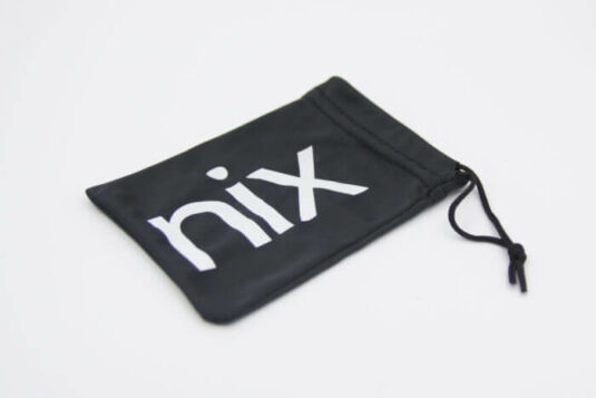 A black pouch with the Nix logo in white sits on a white surface