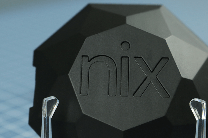 The close-up of the Nix Pro lid is shown, highlighting the Nix logo engraved into to